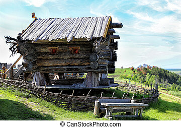 old wooden log house on the hill