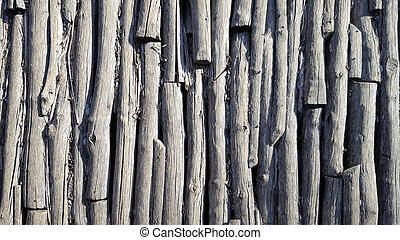 Old wooden logs as background texture