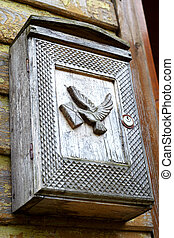 Old wooden mailbox with the pigeons