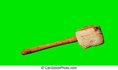 Old wooden mallet at green chromakey background