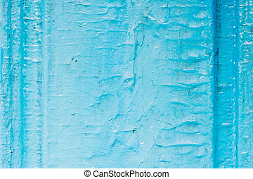 Old wooden painted light blue rustic background with peeling paint. Painted chipped and texture of the wooden surface with oil paint. Damaged texture or background