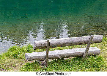 Old wooden park bench in a park
