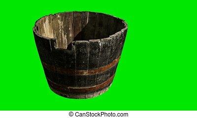 Old wooden pelvis on green chromakey background
