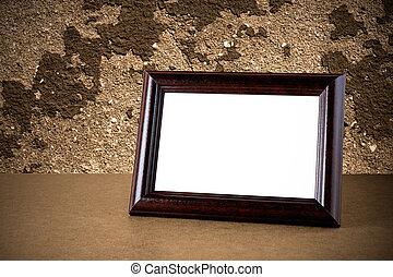 Old wooden photo frame on grunge background