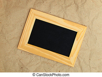 wooden photo frame on old background
