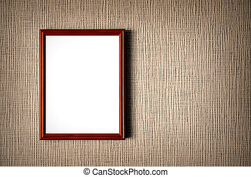 Old wooden photo frame on wall background