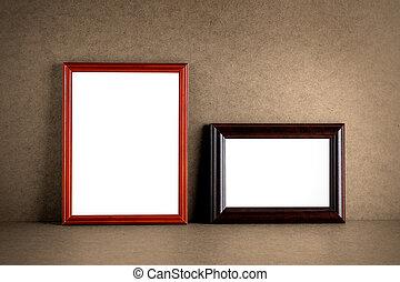 Old wooden photo frames on grunge background