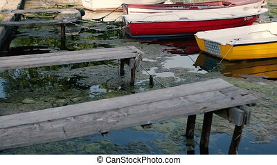 Old wooden pier and fishing boats.