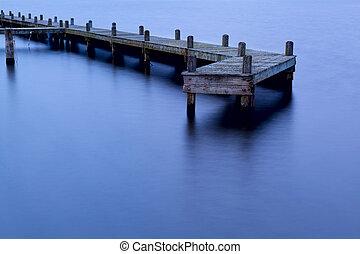 old wooden pier at dusk