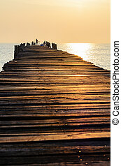 Old wooden pier at sunrise
