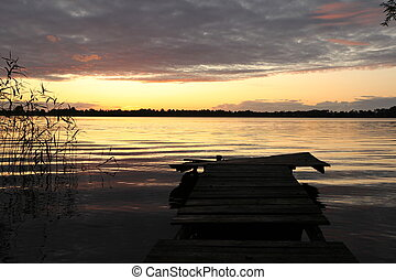 old wooden pier at the lake
