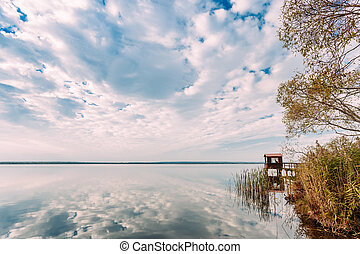 Old Wooden Pier For Fishing, Small House Or Shed And Beautiful Lake Or River