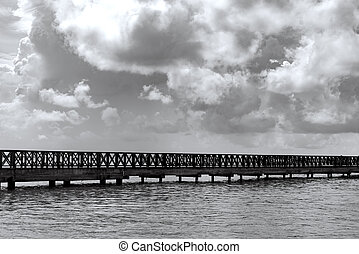 old wooden pier goes to sea