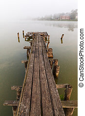 old wooden pier on a misty lake