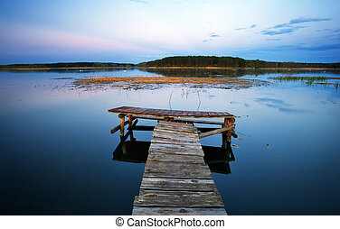 Old Wooden pier on the lake. Long exposure.