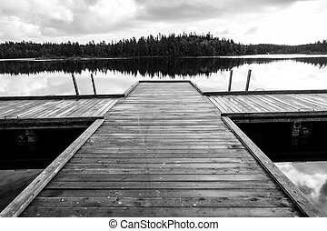 Old wooden pier on the lake on the Solovetsky Islands