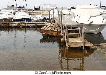 old wooden pier over calm sea