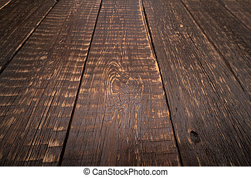 Old wooden plank background with selective focus.