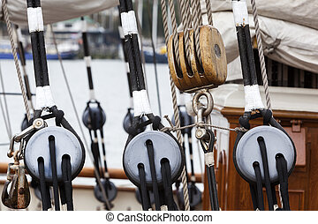 Old wooden pulley on a sailing boat