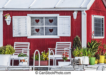 """Old Wooden Red - White Painted """"Love"""" Raft Hut On Sava River"""