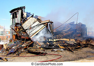 Old wooden residential house after a fire - Old wooden...