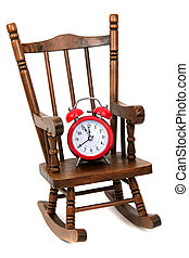 old wooden rocking chair and red alarm bell on white