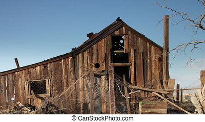 old wooden ruined house in mojave desert