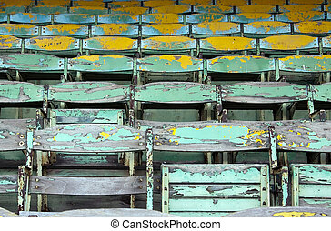Old Wooden Seats - Old painted wooden seats of a stadium...