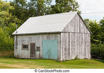 Old Wooden Shed - An old wooden shed outside during the day