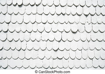 old wooden shingles siding painted white