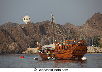 Old wooden ship in the harbor of Muscat, Sultanate of Oman