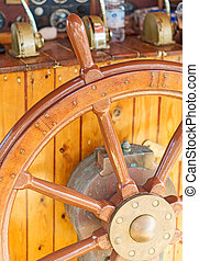 Old wooden ship's wheel.