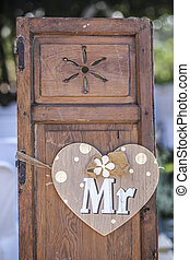 Old wooden shutter windows with hanging heart for Mr