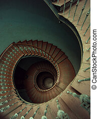 Old wooden spiral stairs in palace - Old wooden spiral...