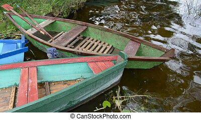 old wooden summer boats on lake