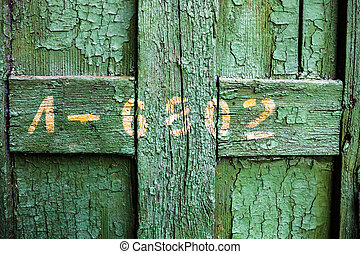 Old wooden surface with cracked green oil-paint