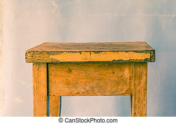 Old wooden table on a dirty background