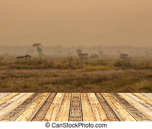 Old wooden table with blurred backgound for anydesign