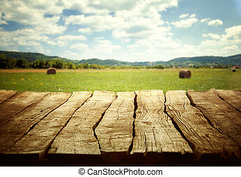 Wooden empty table. Wooden display with spring fields bokeh.