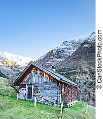 old wooden timber chalet in snowy tirol mountain alps