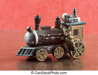 old wooden train with presents and teddy