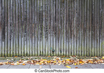 Old wooden trunk fence