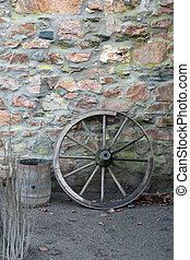 Old wooden wagon wheel and barrel