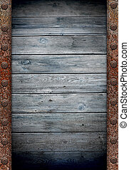 old wooden wall in rusty metal frame texture