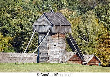 Old wooden windmill at ethnographic museum Pirogovo, Kiev, Ukraine