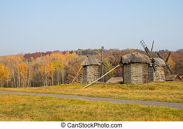 Old wooden windmill in autumn
