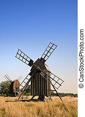 Old Wooden Windmills In Sweden