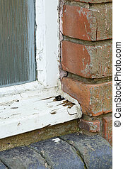 Old wooden window frame rot - Detail of rot in an old wooden...