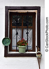 Old wooden window frame with hanged pottery