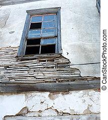 Old wooden window in ruin